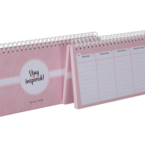 Nahaufnahme vom rosa Tischkalender mit Wochenübersicht