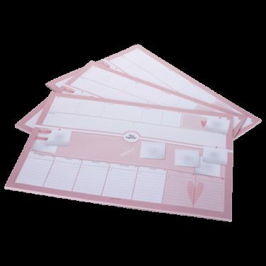 rosa Schreibtischunterlage im DIN A2-Format mit Post-it-Notizzetteln