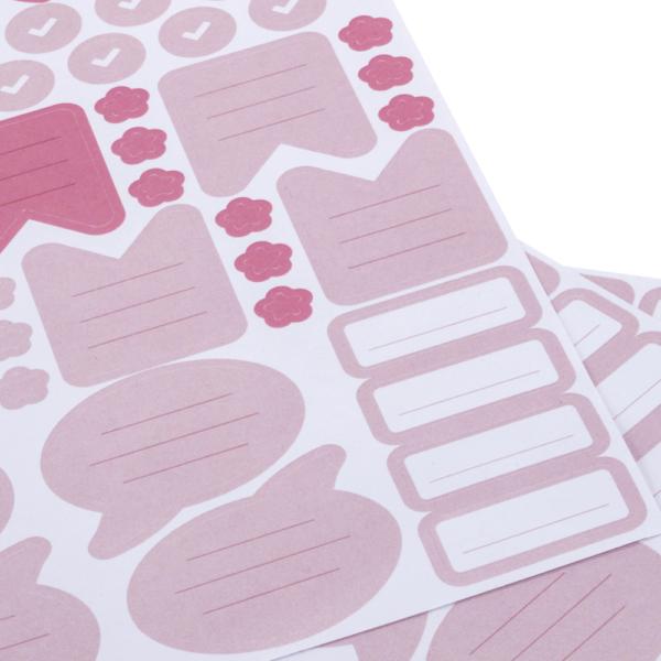Stickerbogen mit rosa Stickern, wie Blumen, Sprechblasen, ToDo-Listen