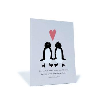 """Weihnachtskarte mit Pinguinen und rotem Herz """"Was wirklich zählt zur Weihnachtszeit"""""""