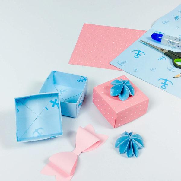 Scrapbookingpapier und Bastelpapier aus dem man süße Schachteln, Schleife und Deko basteln kann